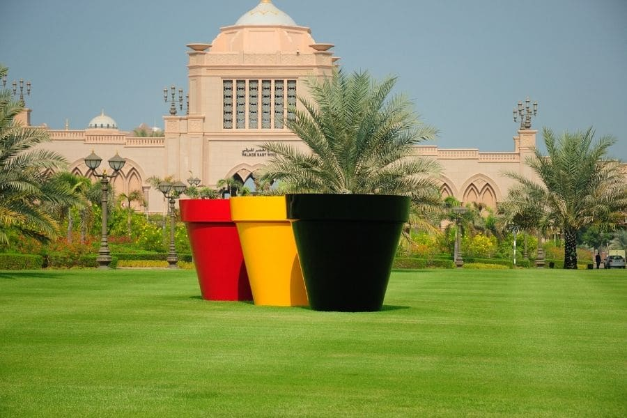 3 large pots in the colours of Belgium at Abu Dhabi