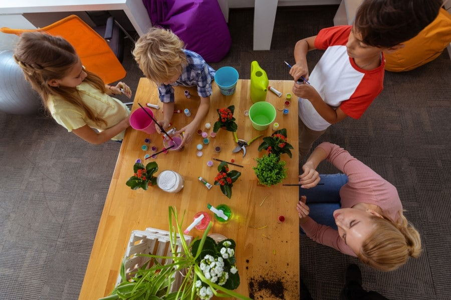 kids making flower pots